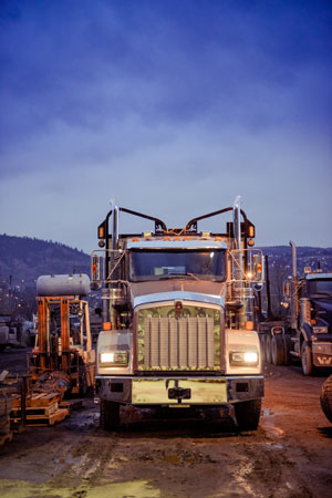 truck at dusk with lights on at Munden Ventures