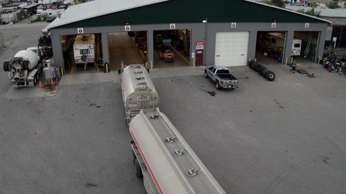 tank truck pulling into one of many mechanic bays at munden ventures